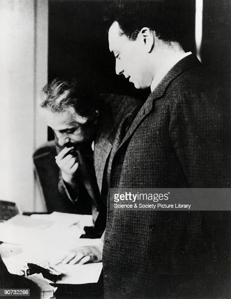 Photograph of Albert Einstein and Wolfgang Pauli Between 1900 and 1930 physics changed dramatically because of the development of two theories...