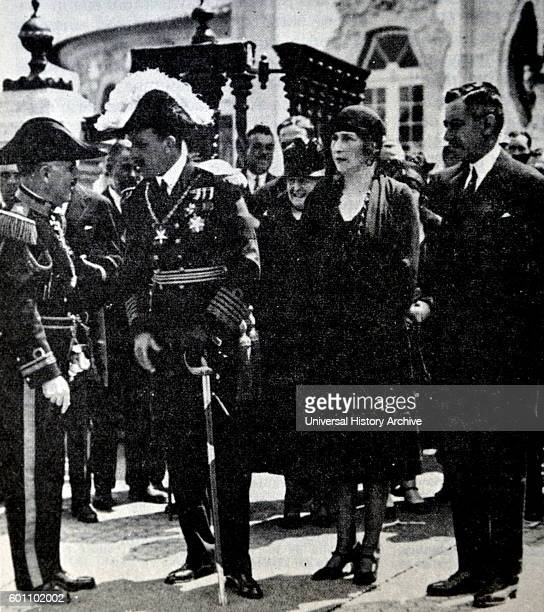 Photograph of Alfonso XIII of Spain and Victoria Eugenie of Battenberg received by Primo de Rivera in the opening of the International Exhibition of...