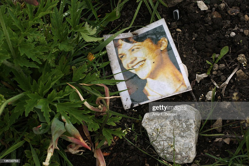 A photograph of American writer and poet Sylvia Plath (1932 - 1963) on her grave at St Thomas a Beckett churchyard, Heptonstall, West Yorkshire, 5th May 2011.