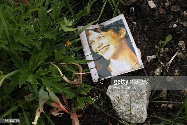 A photograph of American writer and poet Sylvia Plath on her grave at St Thomas a Beckett churchyard Heptonstall West Yorkshire 5th May 2011