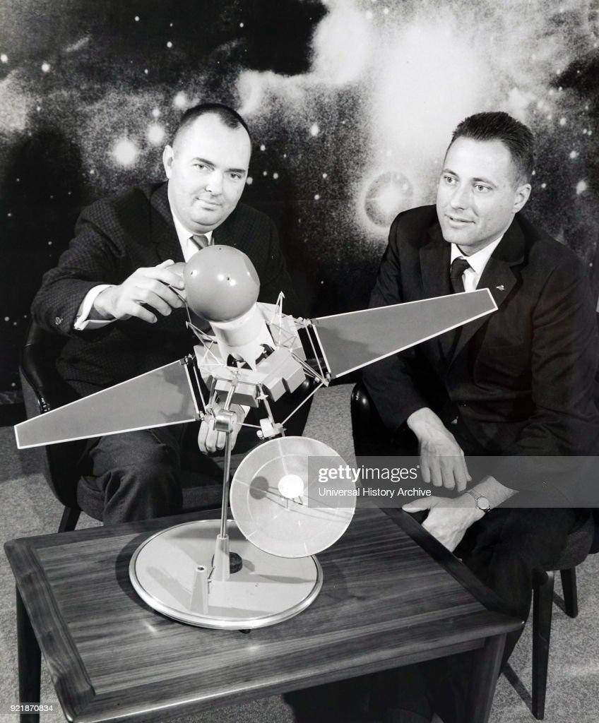 Photograph of an advanced model of the Ranger 3 spacecraft and the lunar capsule. Also pictured is Dr. Donald B. Duncan (left), general operations manager of Space System Operations at Aeronutronic Division of Ford Motor Company, where the capsule is being deployed; and James D. Burke, Ranger project manager at the Jet Propulsion Laboratory. Dated 20th century.