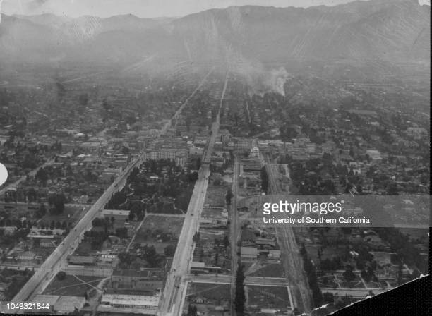 Photograph of an aerial view of Pasadena looking north along Fair Oaks Avenue and Raymond Avenue with Central Park the Hotel Green and a railroad...