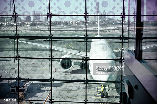 photograph of an airport runway and a plane on a sunny day - dubai airport stock photos and pictures