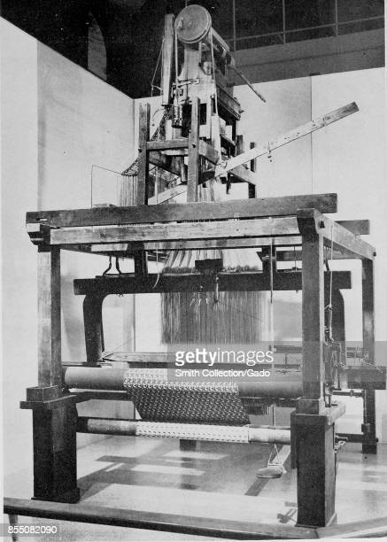 Photograph of an antique French loom which has been retrofitted with a Jacquard attachment allowing the loom to mechanically weave complex fabric...