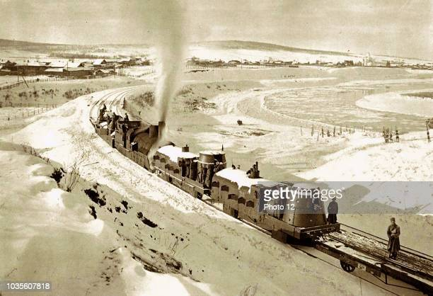 Photograph of an armoured train traveling through Irkutsk, Siberia. Dated 1919.