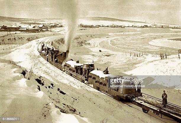 Photograph of an armoured train traveling through Irkutsk, Siberia. Dated 1919