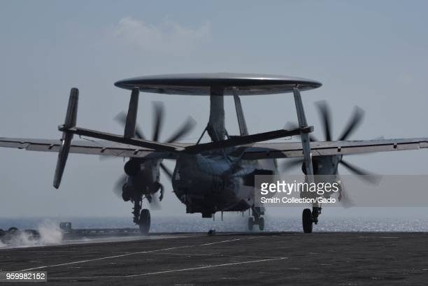 Photograph of an E-2D Hawkeye early warning aircraft taking off from the deck of the aircraft carrier USS Harry S. Truman, May 9, 2018.