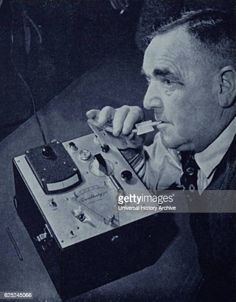 Photograph of an early breathalyser being demonstrated in London The machine determines the level of alcohol in the bloodstream Dated 20th Century