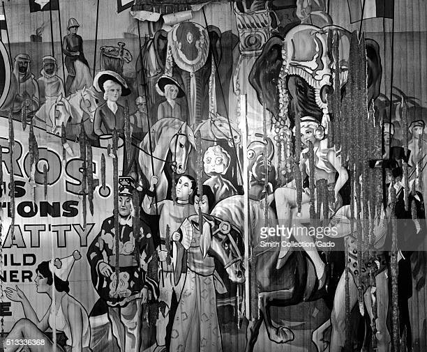 A photograph of an illustrated poster for the circus the poster was pasted to a wall and can be seen peeling the illustration features performers in...