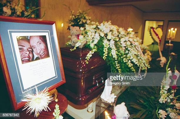 A photograph of Anna Nicole Smith and J Howard Marshall II sits next to Marshall's casket Anna Nicole Smith attends the memorial service for her...