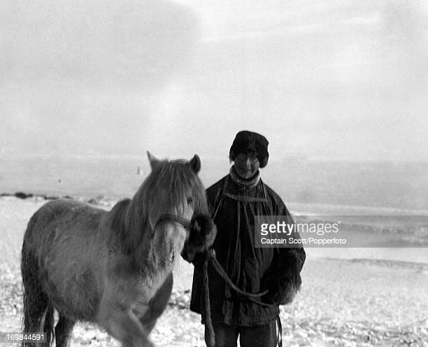 A photograph of Apsley Cherry Garrard with the pony Michael at Cape Evans taken during the last tragic voyage to Antarctica by Captain Robert Falcon...