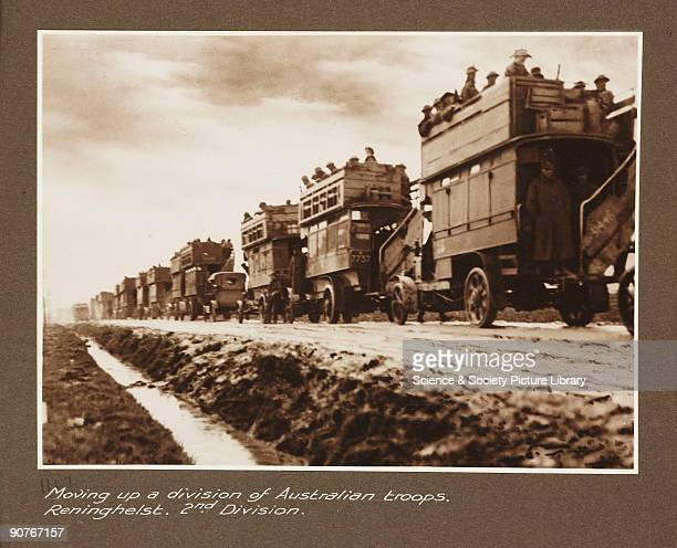 A photograph of Australian soldiers being transported to the front line in a convoy of converted omnibuses taken by an unknown photographer in about...
