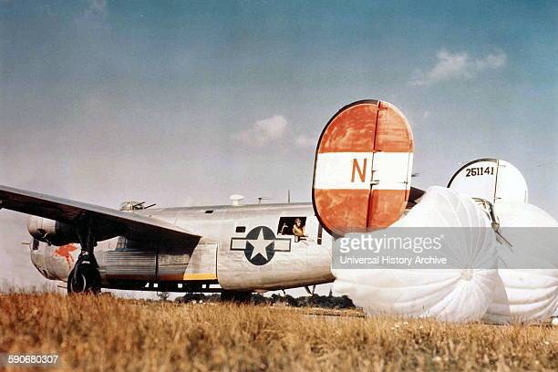 """Photograph of B24H Liberator """"Pegasus The Flying Red Horse"""" of the 784th Bomb Squadron landing at RAF Attlebridge Norfolk Dated 1944"""