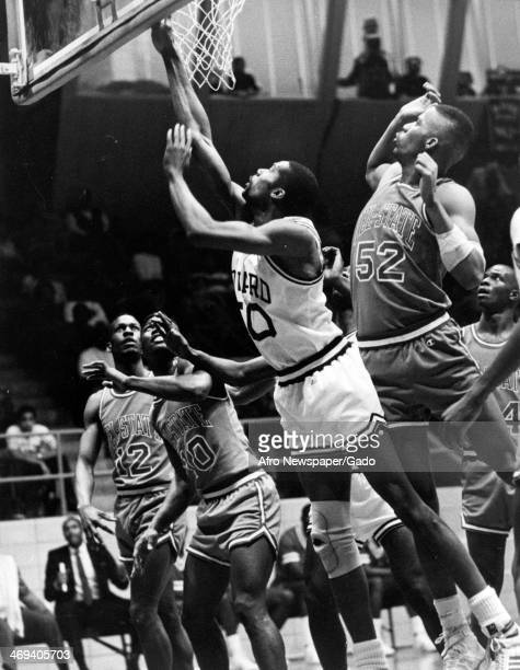 A photograph of basketball players during a game between Howard University Bisons and Delaware State University Hornets Washington DC 1980
