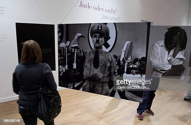 A photograph of British comedian Charlie Chaplin playing Adolf Hitler in his 1940 film 'The Dictator' is on display at the 'The Whole Truth...