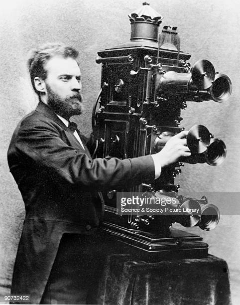 Photograph of C Goodwin Norton operating a three lens triunial lantern Norton was a well known lantern entertainer of the 1890s The triunial lantern...