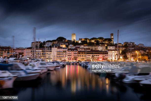 Photograph of Cannes and it marina during blue hour.  French Riviera, France