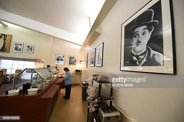 A photograph of Charlie Chaplin is seen in the dining room at the Motion Picture Television Fund Country House a retirement community for members of...