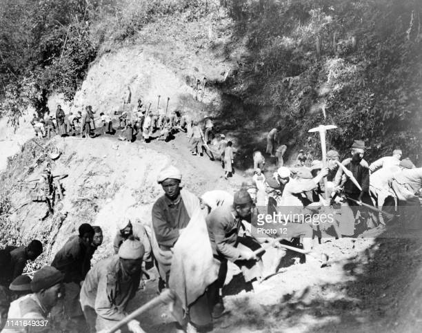 Photograph of Chinese labourers working to reopen the Burma Road in southwest China. Dated 1944.