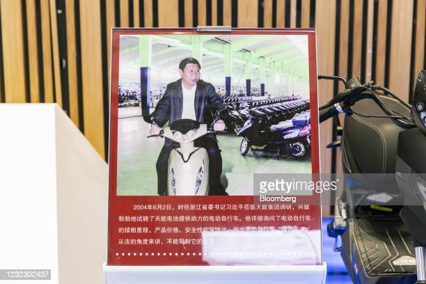 Photograph of Chinese President Xi Jinping riding on an electric scooter equipped wit Tianneng Battery Group Co. Batteries in an exhibition area...