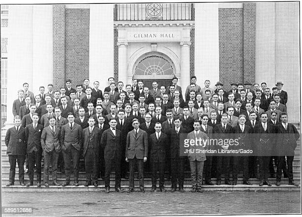 Photograph of Class of 1924 dressed in suits standing on the steps of Gilman Hall at Johns Hopkins University Baltimore Maryland 1924