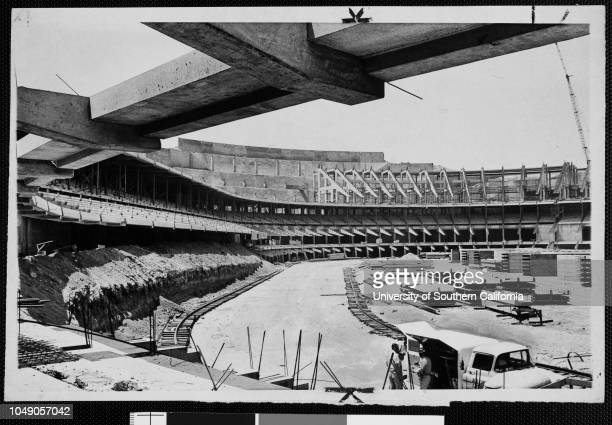 Photograph of construction of the New Dodgers Stadium in Chavez Ravine, Los Angeles. 'Next year it will be a new, modern stadium in Chavez Ravine for...