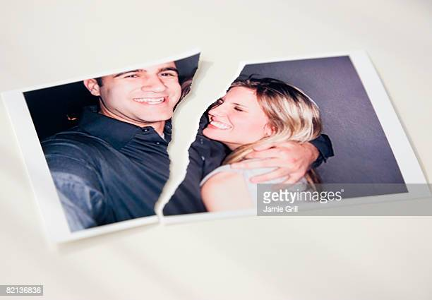 photograph of couple ripped in half - fotografie stock-fotos und bilder