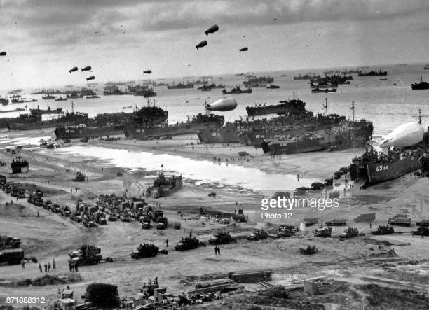 Photograph of DDay landing craft boats and seagoing vessels used to convey a landing force from the sea to the shore during an amphibious assault...