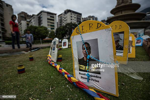 A photograph of deceased protestor Bassil Da Costa is displayed at a memorial in Altamira Plaza for opposition protesters who have been injured or...
