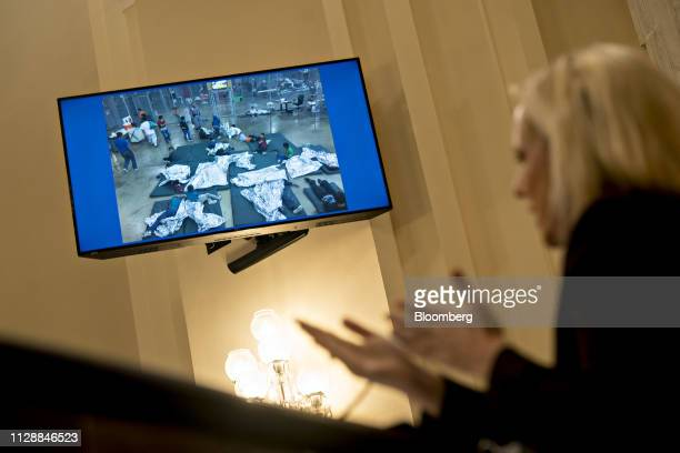 A photograph of detained children is displayed on a monitor as Kirstjen Nielsen US secretary of Homeland Security right speaks during a House...