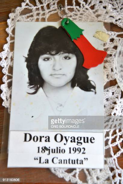 A photograph of Dora Oyague is seen at her cousin Carolinas home in a middleclass neighbourhood in Lima on January 29 2018 Dora Oyague and eight...