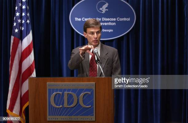 Photograph of Dr David Fleming speaking at an official CDC media event updating the press on the number of reported monkeypox virus infections and...