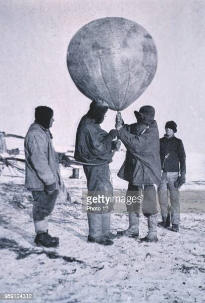 Photograph of Dr Simpson sending up a balloon during the 1910 British Antarctic Expedition Photographed by Herbert G Ponting professional...