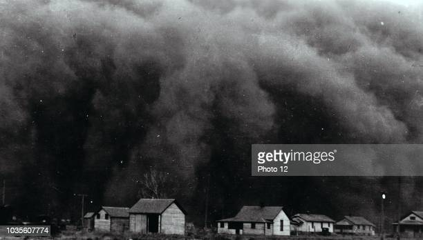 Photograph of dust clouds covering the Prairies, during the Great Depressions of America. Dated 1935.