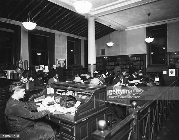 Photograph of Ernestine Rose working at the 135th Street branch of the New York City Public Library, she lead the library in activities that is...