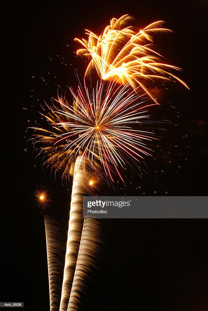 photograph of fireworks exploding through the night sky : Stock Photo