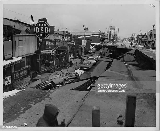 A photograph of Fourth Avenue in Anchorage following the 1964 Alaska Earthquake an 11 foot subsidence occurred along with 14 feet of horizontal...