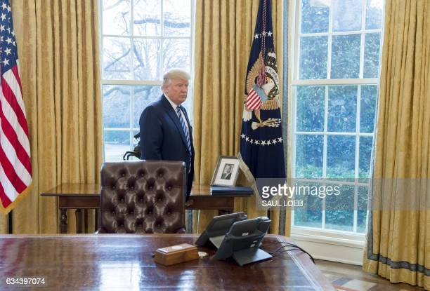 A photograph of Fred Trump the father of US President Donald Trump is seen in the Oval Office of the White House in Washington DC February 9 2017 /...