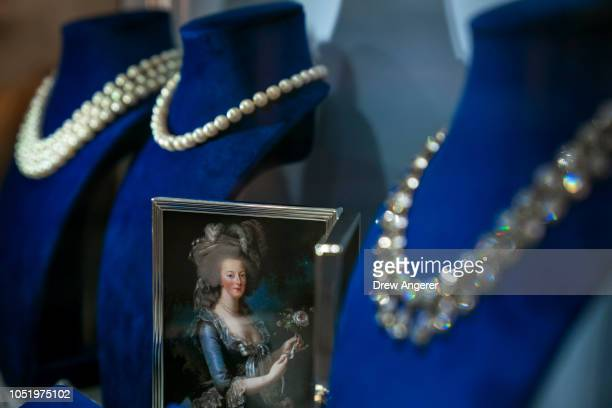 A photograph of French Queen Marie Antoinette is displayed amongst her jewelry at at Sotheby's auction house October 12 2018 in New York City The...