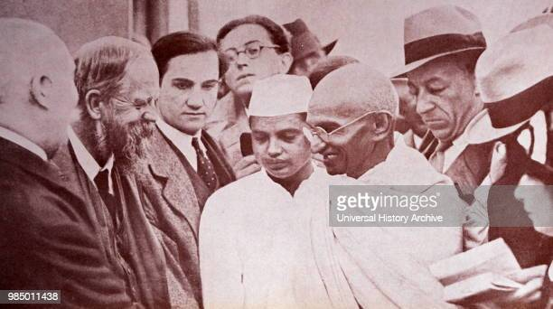 Photograph of Gandhi with reporters taken at Marseilles in France 1931 Mohandas Gandhi was the preeminent leader of the Indian independence movement...