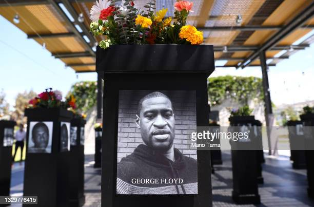 Photograph of George Floyd is displayed along with other photographs at the Say Their Names memorial exhibit at Martin Luther King Jr. Promenade on...