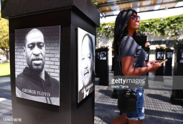 Photograph of George Floyd is displayed along with others at the Say Their Names memorial exhibit at Martin Luther King Jr. Promenade on July 20,...