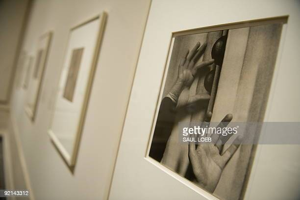 A photograph of Georgia O'Keeffe's hands by her husband Alfred Stieglitz from 1919 is displayed during an exhibition titled 'In the Darkroom...