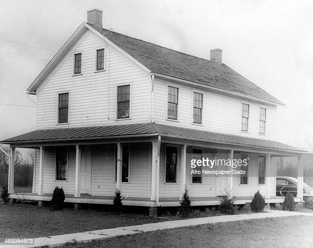 A photograph of Harriet Tubman Home a white wooden house with a run around porch Auburn New York 1940