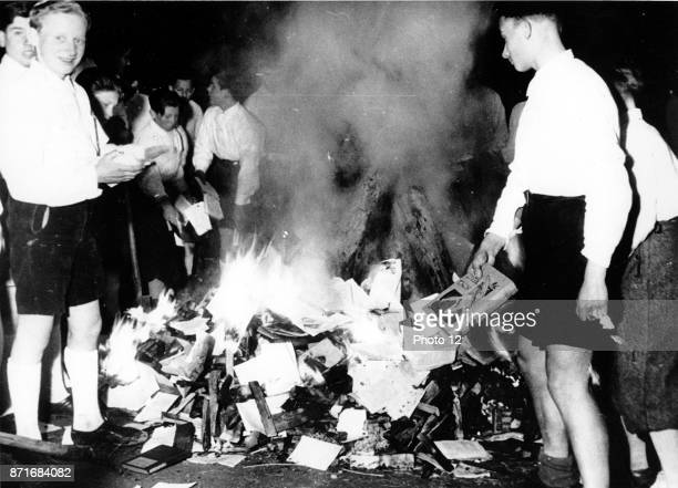 Photograph of Hitler Youth members burning books. Dated 1938.