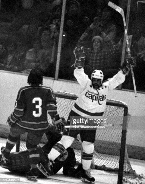 A photograph of hockey goalie Mike Marsh of the Washington Capitals with his hands in the air Washington DC 1980