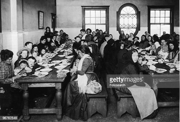 Photograph of Immigrants Eating in the Dining Hall on Ellis Island, New York circa 1880.