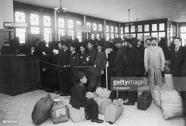 Photograph of Immigrants lining up at the Money Exchange on Ellis Island, New York circa 1880.