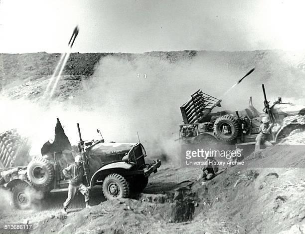 Photograph of International harvest trucks at Iwo Jima after navy barrage rockets hit. Dated 1945