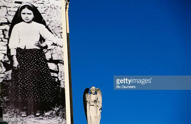 photograph of jacinta marto and angel statue - our lady of fatima stock pictures, royalty-free photos & images